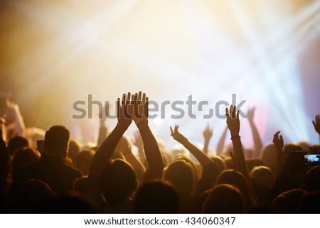 Hands of fans during a concert