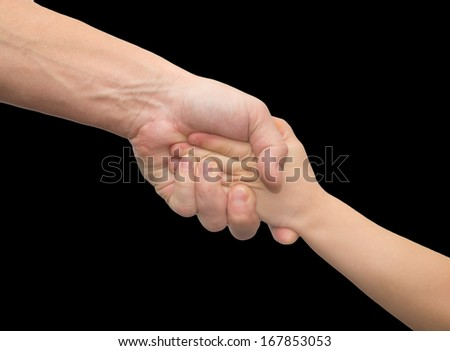 hands of father and son on a black background