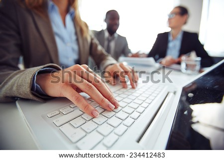 Hands of female employee typing