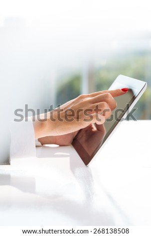 Hands of female manager with digital tablet: technology in business concept