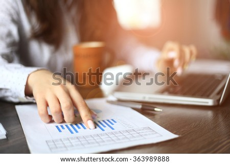 Hands of financial manager taking notes when working  - stock photo