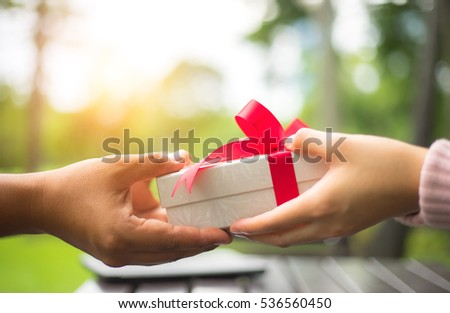 Hands of friend giving