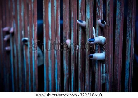 Hands of ghosts holding Fence , Halloween image. - stock photo