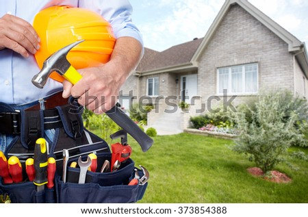 Hands of Handyman with a tool belt.  - stock photo