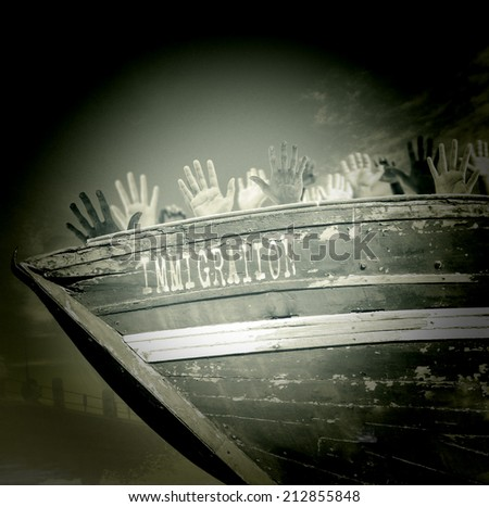 hands of illegal immigrants in a boat - stock photo