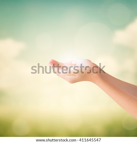 Hands of little girl on natural vintage paper background