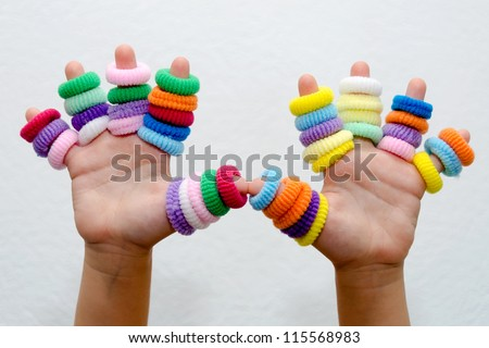 hands of little girl with colorful hair bands