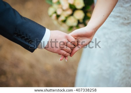 Hands of lovers newlyweds with rings