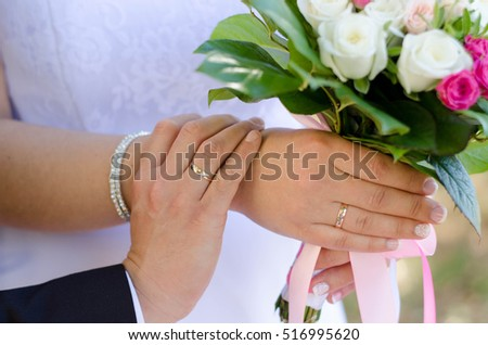 Hands of lovers with the rings on wedding day