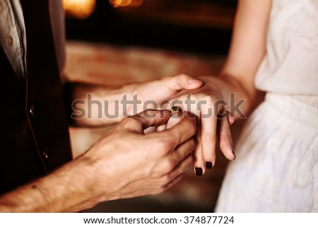 Hands of Loving Couple Close Up. Man Puts a Woman Engagement Ring. Selective Focus on Woman`s Hand.