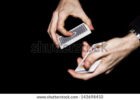 Hands of magician doing a magic trick - stock photo