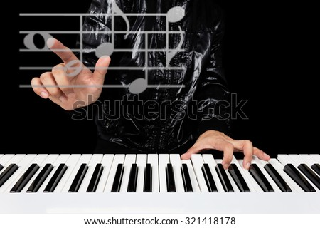 hands of male artist playing piano and composing songs in the cyberspace, isolated on black for music production technology concept - stock photo