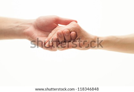 Hands of man and woman holding together - stock photo