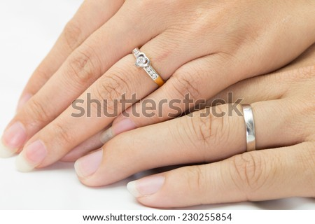 Hands of man and woman with ring - stock photo