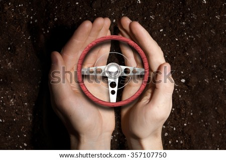 Hands of man holding with care car steering wheel - stock photo