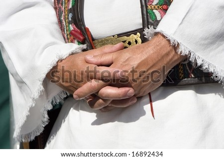 hands of man in folk costume