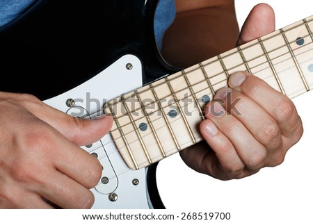 Hands of man playing electric guitar. Guitarist hands. Fingers bending strings on maple fretboard closeup isolated on white. Bend technique. - stock photo
