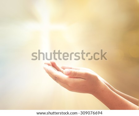Hands of man praying on blurred bokeh the cross on sunset background. Christmas background, Evangelical, Mercy Year, Humble, Repentance, Hallelujah, Surrender, Thanksgiving, Blessing, 2016 concept - stock photo