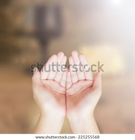 Hands of man praying over blurred glass of wine and Loaf of bread in eucharist of christian. Worship, Forgiveness, Mercy, Humble, Repentance, Reconcile, Adoration, Glorify concept. - stock photo
