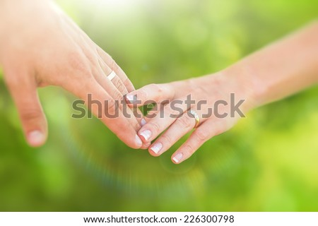 Hands of married man and woman