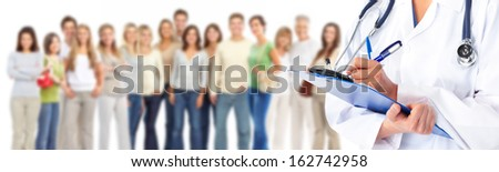 Hands of medical doctor over people group background. - stock photo