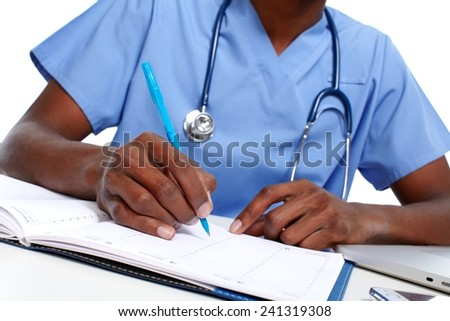 Hands of medical doctor writing prescription in office - stock photo