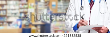 Hands of medical doctor writing prescription over blue background - stock photo