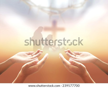 Hands of men praying over blurred The cross and Nativity scene story, Christmas background, Glory to God in the highest, and on earth peace among those with whom he is pleased, Thanksgiving concept. - stock photo