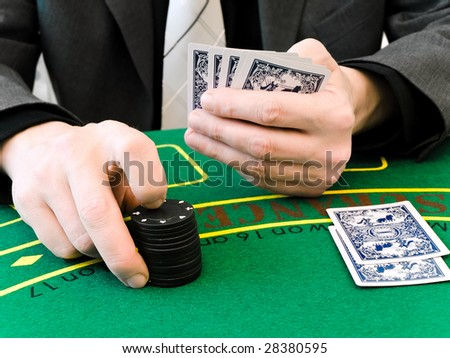 hands of men who makes a bet at the casino - stock photo