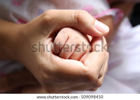 hands of mother and baby