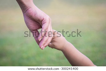 hands of mother and child.