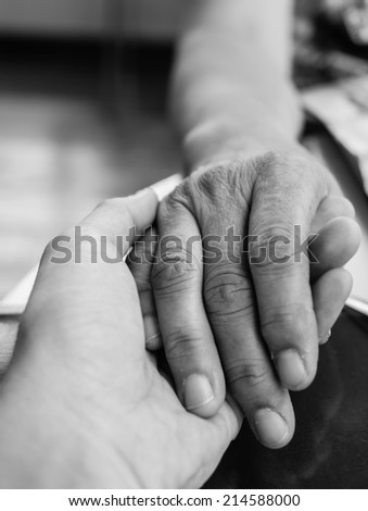 Hands of mother and son holding together in monochrome style