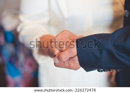 hands of mother at the wedding - stock photo