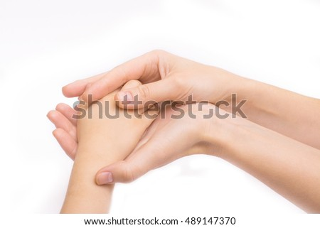 hands of mother holding baby's hand. isolate on white background