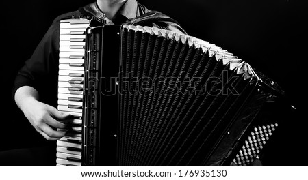 Hands of musician accordionist  and  frayed keys of  accordion