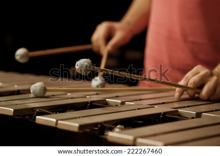 Hands of musician playing the vibraphone - stock photo
