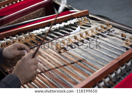 hands of musician with a zither - stock photo