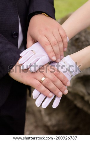Hands of newlyweds, gold rings and wedding union