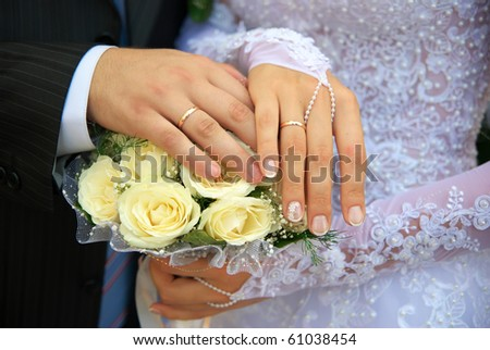 Hands of newlywedses. Element of design. - stock photo