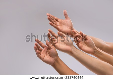 Hands of people begging for help - stock photo