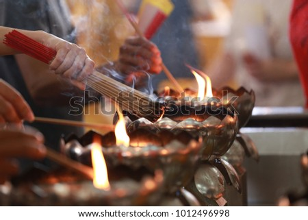 Hands of people lighting incense sticks on open flame & Light Incense Stock Images Royalty-Free Images u0026 Vectors | Shutterstock