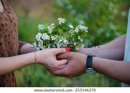 Hands of romantic couple
