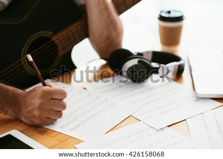 Hands of songwriter working on new composition, selective focus - stock photo