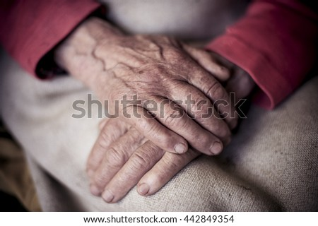 hands of the elderly woman close-up.