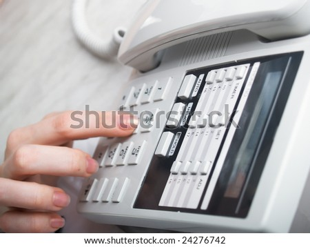 Hands of the girl dial number on phone