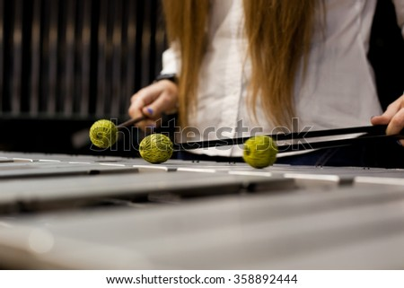 Hands of the girl playing the xylophone - stock photo