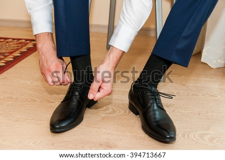 Hands of the groom