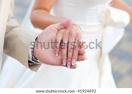 hands of the groom and bride