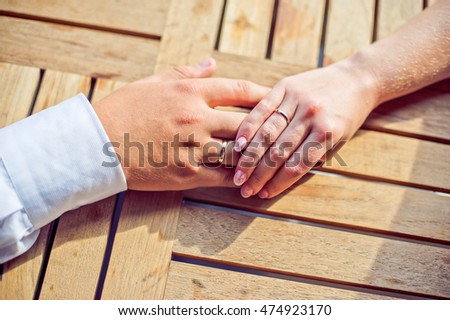 Hands of the groom and the bride with wedding rings. Wedding concept