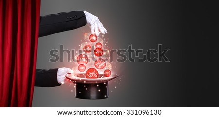 Hands of the magician and top hat on stage, concept  Christmas  discounts - stock photo